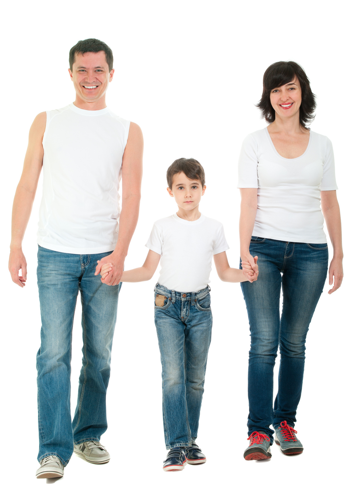 Smiling family walking in jeans full body holding hands isolated on white